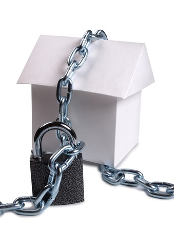 building a chain: Paper model house and padlock on white background