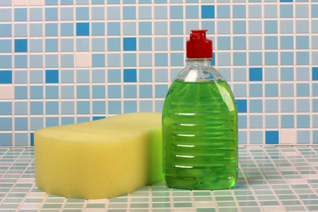 Soap and cleaning products on tile background