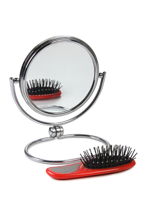 comb: Hairbrush and mirror on a white background Stock Photo
