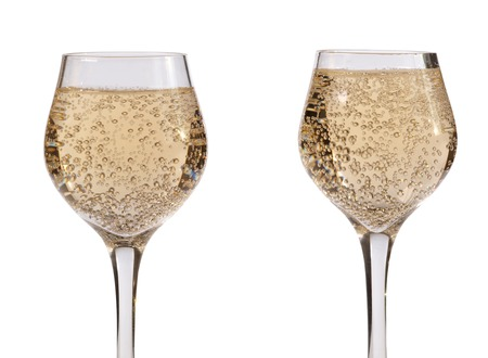 Champagne in wineglass on white background