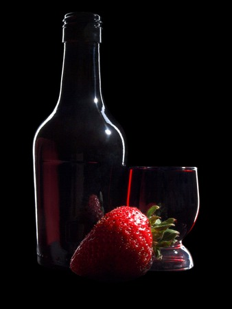 Glass and bottle wine on black background Stock Photo