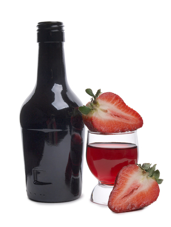 Fresh strawberry and cocktail in a glass on a white background