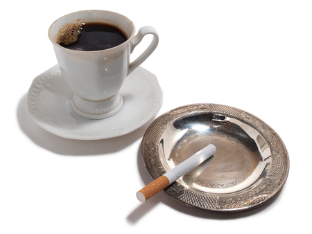 Cigarette and cup of coffee on a white background
