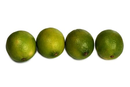 Green lemon fruits on a white background Stock Photo