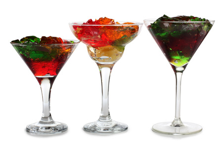 daiquiri alcohol: Fruit cocktail in a glass goblet on a white background
