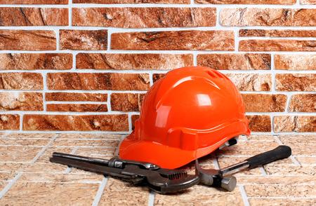 Work tool and helmet on stones background Stock Photo
