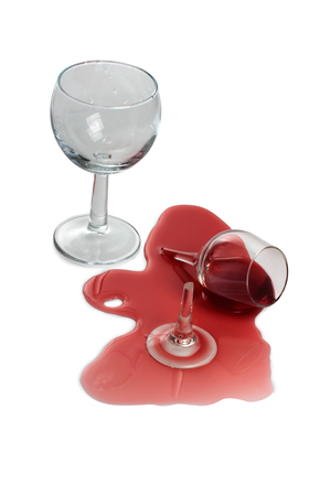Broken glass and spilled red wine on white background Stock Photo