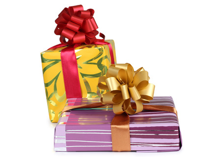 christmas gift: Color box and red ribbon on white background