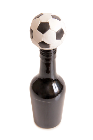 Glass beer mug and a ball on a white background