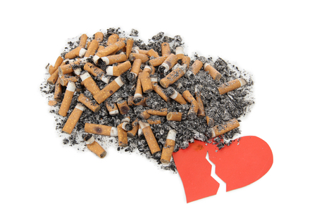 Sign of heart and nicotine sigarette on white background Stock Photo