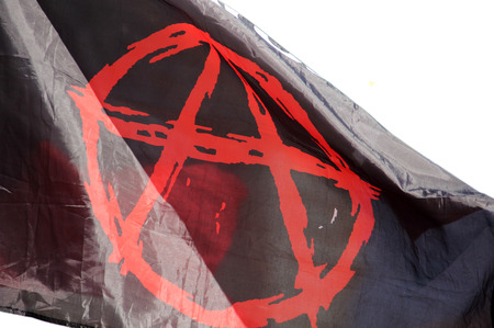 Flag with an anarchy fluttering in the wind 스톡 콘텐츠