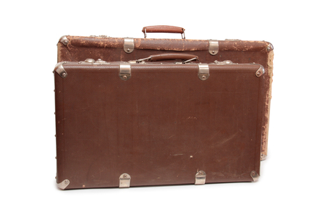 Ancient suitcase for travel on a white background