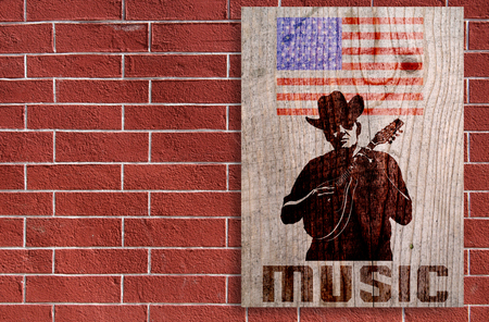 Poster whit cowboy in hat and mandolin on a brick background Stock Photo