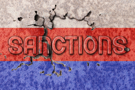 Word sanctions and russia are painted on a brick background Stock Photo