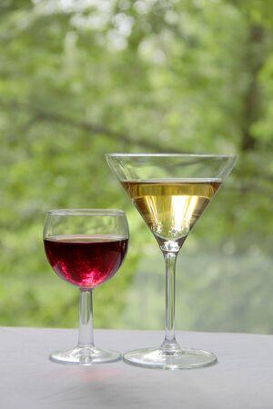 Vintage glass goblet on green background