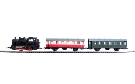 Model of a steam locomotive and cistern on rails on a white background Stock Photo