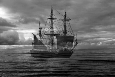 Retro sailing ship on sea and dramatic sky