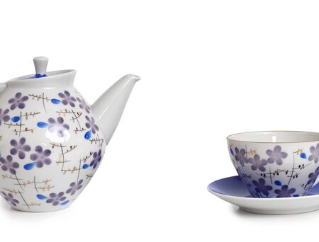 Antique porcelain tableware for tea on a white background with place for your text Фото со стока