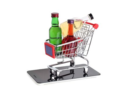 Metal cart whit bottle from store on white background