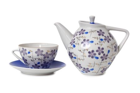 Vintage tea cups and teapot on table. Isolated objects on a white background Фото со стока