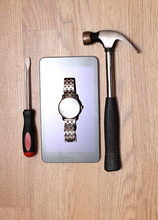 Work tools and modern smartphone on a wooden board. Homework image