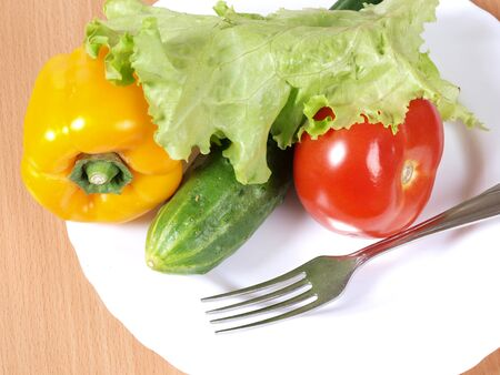 Multi-colored sweet peppers on a plate. Ingredients for cooking