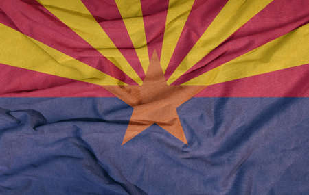 Flag of the American state flies in the wind. Colored background on fabric 写真素材 - 154202770