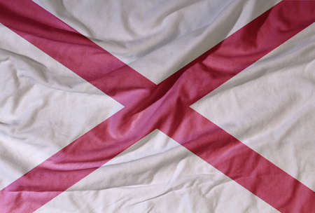 Flag of the American state flies in the wind. Colored background on fabric 写真素材 - 154202771