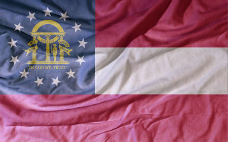 Flag of the American state flies in the wind. Colored background on fabric 写真素材 - 154202783