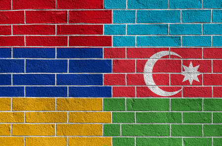 Flags of armenia and azerbaijan on old brick wall