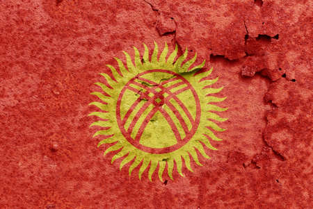 Kyrgyzstan flag on old rusty piece of metal