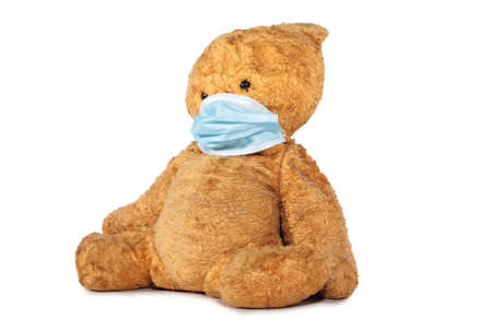 Teddy bear in a medical mask. Isolated object on white background