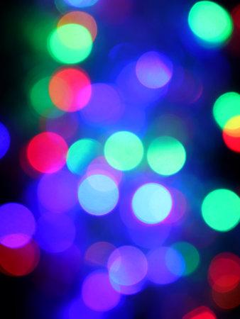 Colored lights spots on a black background