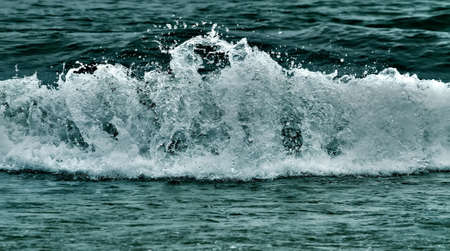 sea wave, spray emitted in all directions photo