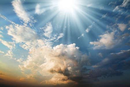 rays of light on the rich dark clouds. blue sky Standard-Bild