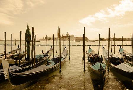 Venice  Sea  At the coast there are moored gondolas  Imitation of antiques Stock Photo - 13759500