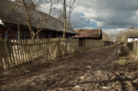 stockade: Dirt road passing through the small village  Old wooden house  Along the road - a wooden stockade