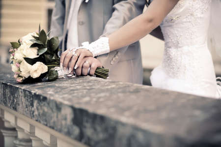 couple s hands holding wedding bouquet of flowers  Imitation of antiquity