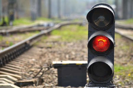 Traffic light shows red signal on railway. Red light