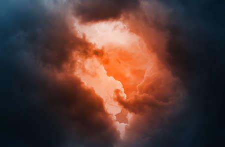 Stormy Skies. Orange Gleam Among the Dark, Saturated Clouds.