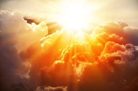 sunlight: The bright rays of the sun are shining from saturated clouds Stock Photo