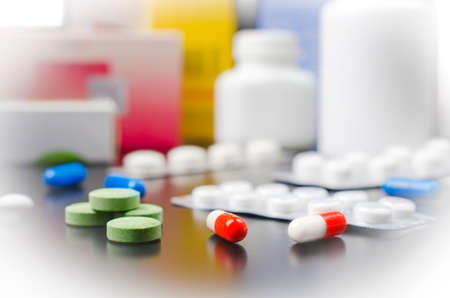 prescribed: A variety of medicines and drugs on the light surface