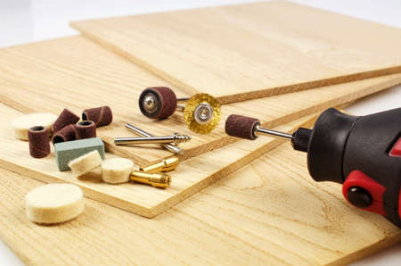 graver: Engraving machine and accessories are on the thin oak the boards