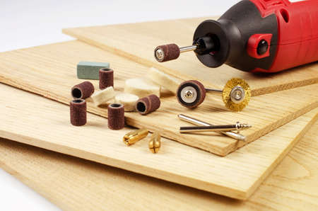 emery: Engraving machine and accessories are on the thin oak the boards