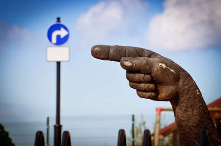 Wooden hand. The index finger indicates the sign of the turn in the opposite direction Banco de Imagens - 79929407