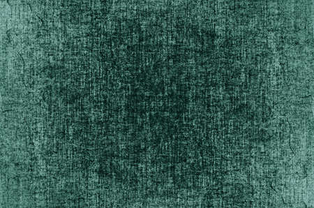 Green fabric texture background. Detail of canvas textile material.