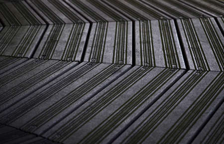 Texture of black terraced boards. Background of decking.