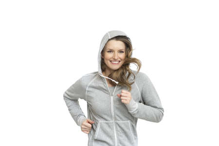 Running woman smiling happy portrait  Fresh and beautiful in sport grey top isolated on white background
