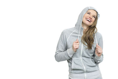 Woman smiling happy portrait  Fresh and beautiful in sport grey top isolated on white background Stock Photo
