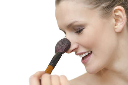Closeup portrait of woman s face - makup - with brush isolated over white background Stock Photo